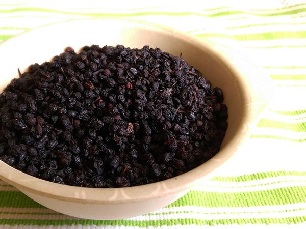Dry elderberries in bowl
